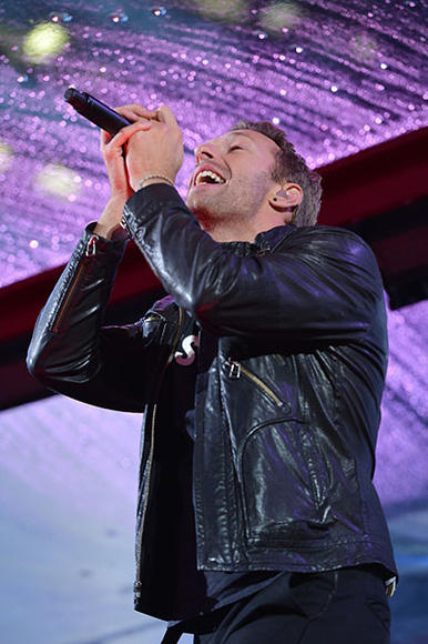 Chris Martin of Coldplay performing with U2
