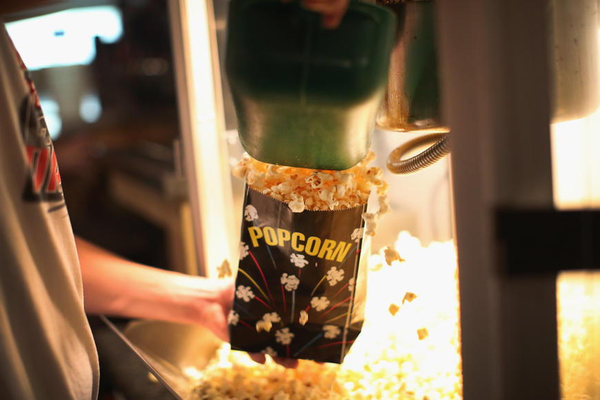 Tip #3: Love popcorn? Get a large, refillable popcorn bucket and treat yourself to free flavor shakers, too!