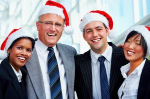 Christmas fun at the office - Portrait of a multi ethnic business having fun and laughing