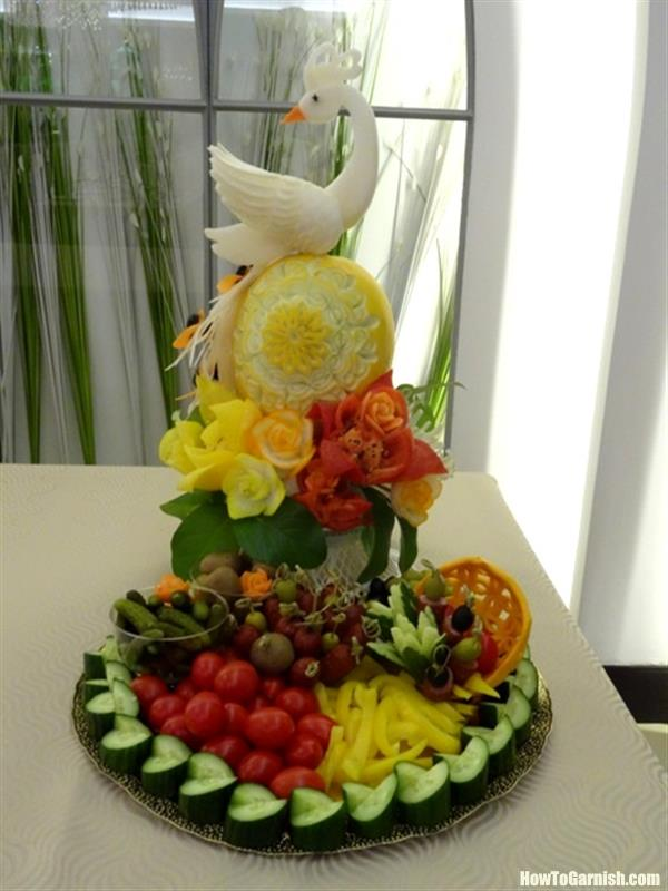 Carving arrangement with melon, daikon bird, and the platter