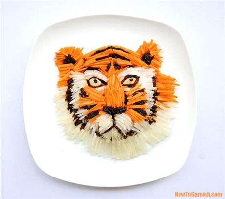 Beautiful tiger made out of carrots, white radish and dried prunes!