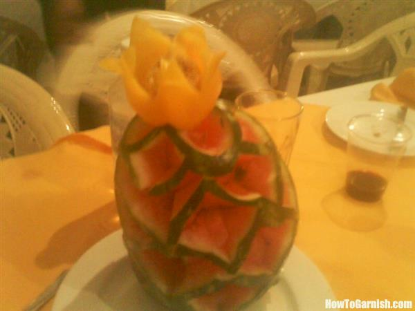 Mellon flower carving with sweet pepper on top