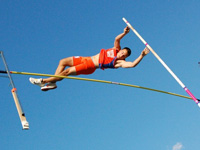 Ross McDonald, competing for Newton South High School in May 2010, in the pole vault