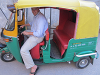 Trying to drive an auto-rickshaw