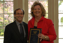 Mario Venancio receives top awards from Patricia Bell, CEO of Gloria Nilson GMAC Real Estate.