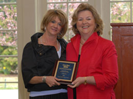 Pat Bell (right), president of Gloria Nilson GMAC Real Estate, presents the GMAC Real Estate National Top 50 Team Producers in 2007 award to Linda Schwarz, sales associate with the South Brunswick office.