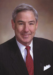 Lewis Glenn, retiring President of Harry Norman, Realtors.