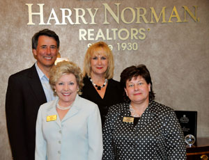(Left to right): Harry Norman, Realtors® Cobb Marietta office top sales associate - Jim Glover, Managing Broker - Patty Kendrick, Company President - Martha Hayhurst, Associate Broker - Sue Priegel.