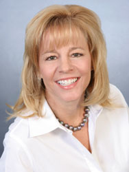 Julie Rembos, an agent with Premier Properties who recently earned her Associate Broker license.