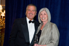 Shari Chase, President and CEO of Chase International, receives her award from John Brian Losh, Chairman and CEO of LuxuryRealEstate.com at a recent conference in Philadelphia.