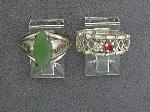 Lot: 1879 - 10K RING W/RED STONE