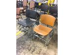 Lot: OF02 - (10 BLACK/6 ORANGE) STACKABLE CHAIRS