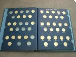 Lot: 2199 - (57) MERCURY DIMES IN COLLECTION BOOK