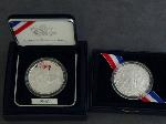 Lot: 185 - (2) 2007 U.S. MINT SIL. JAMESTOWN 400TH COMMEMORATIVES
