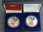 Lot: 192 - (2) 2000 AMERICAN SILVER EAGLES - COLORIZED