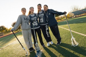 Eimear McElwee practices with her new Lacrosse teammates and coach Jackie Dando