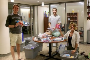 Jen Liedtka works with students to assist hurricane victims