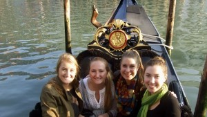 Study abroad students take a gondola ride in Spain