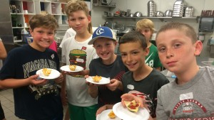 Children in the Activities Camp learn to make snacks
