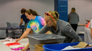 Students assemble hygiene kits for victims of recent hurricanes as part of a community service project