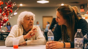 An LVC student speaks with a Londonderry Village resident during their valentine's party