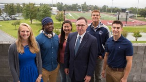President Lewis E. Thayne and students at the new Arnold Health Professions Building