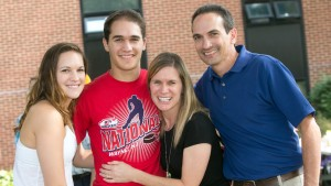 LVC Ice Hockey player, Jared Karas, poses for a photo with family during move in