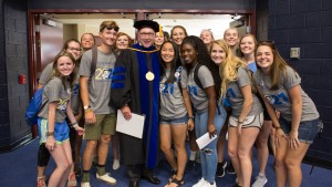 Current and new students from the class of 2021 gather for a picture with President Lewis E. Thayne