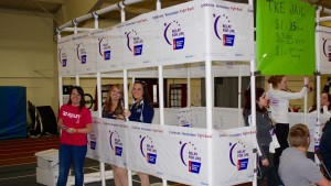 Students sit in a mock jail to raise money at Relay for Life