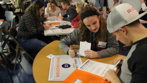 Students collaborate during a poverty simulation at Lebanon Valley College