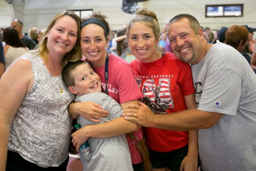 A family poses for a goodbye photo during move-in day