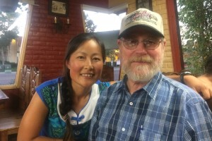 Fei Liu and Dr. Dahlberg pose for a photo at a restaurant.