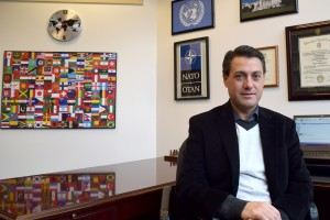 Dr. Chris Dolan sits in his office