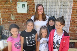 Lebanon Valley College student Nicole Flohr poses with children in Bosnia during her recent service trip