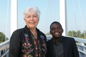 Dr. JonnaLynn Knauer Mandelbaum poses with Shingirai Guchu on Fasick Bridge of Lebanon Valley College