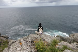 Dr. Holly Wendt looks out at the ocean while traveling