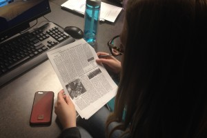 A student in Journalism edits the newest addition of the newspaper, La Vie