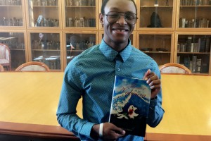 Lebanon Valley College freshman Khalil Brim poses with his novel