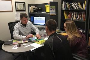 Dr. Kyle Ward works with criminal justice students in his office