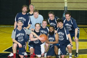 The Faculty Basketball team poses for a team picture