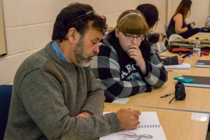 Artist Michael Fay works with a student in the Reportage Art class at Lebanon Valley College