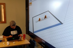 LVC Visioneer works with prototyping software at club meeting.
