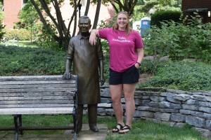 Savannah Toth poses with Hot Dog Frank in the Peace Garden at LVC