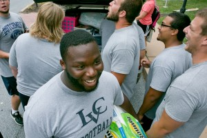 Jacob Whitfield helps the LVC football team move into the dorm rooms