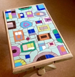 A unique and funky mosaic seat/table