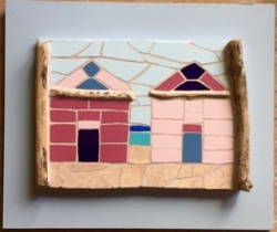Mounted mosaic beach huts with driftwood