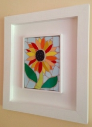 A framed sunflower mosaic