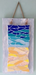 Coastal sea and sand mosaic, mounted on distressed wood with rope wall hanging