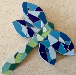 Mosaic dragonfly with blue wings and a green body - exterior/interior wall hanging