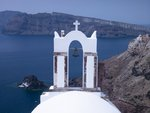 Greece, Cyclades. Santorini Island, Church with mountain in background